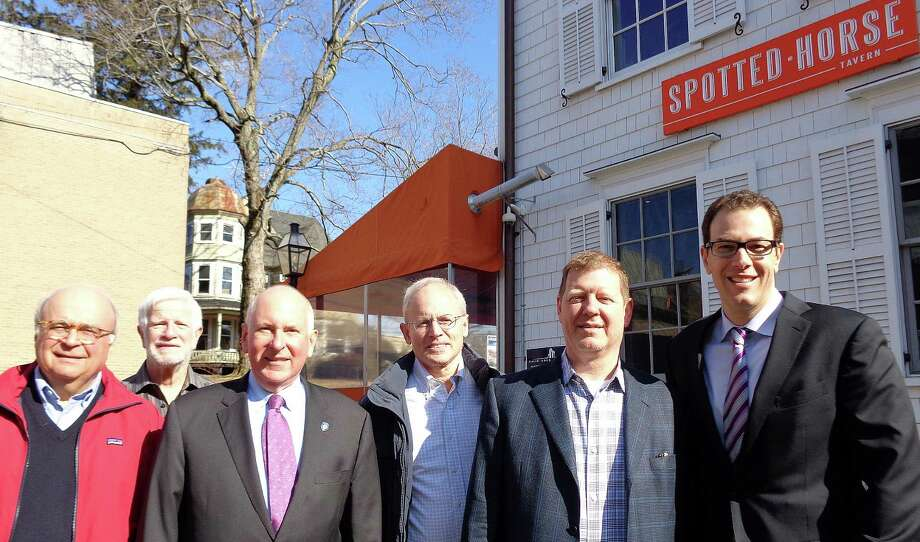 "Assembled in front of the Spotted Horse Taven, the preserved Church Lane building formerly known as the Sherwood Mansion, are from left: : Ed Gerber, Westport Historical Society president; Bob Weingarten, Historic District Commission member; First Selectman Jim Marpe; Francis ""Randy"" Henkels, chairman of the HDC; Rick Hoag, architect for the Spotted Horse, and developer David Waldman, who reversed his initial plan to demolish the structure. In the background is the Kemper Gunn House, which Waldman also has worked to preserve by moving it to a new location. Photo: Meg Barone / Westport News"