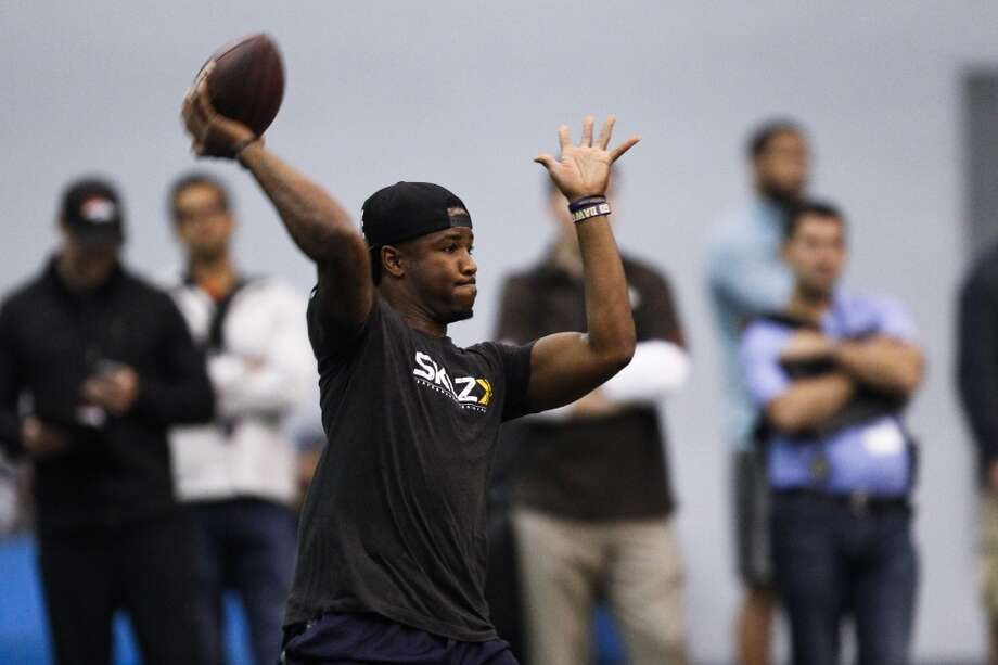 Washington quarterback Keith Price passes during the NFL football pro day at the Dempsey Indoor Practice Facility Wednesday, April 2, 2014, in Seattle. (AP Photo/Joe Nicholson) Photo: AP