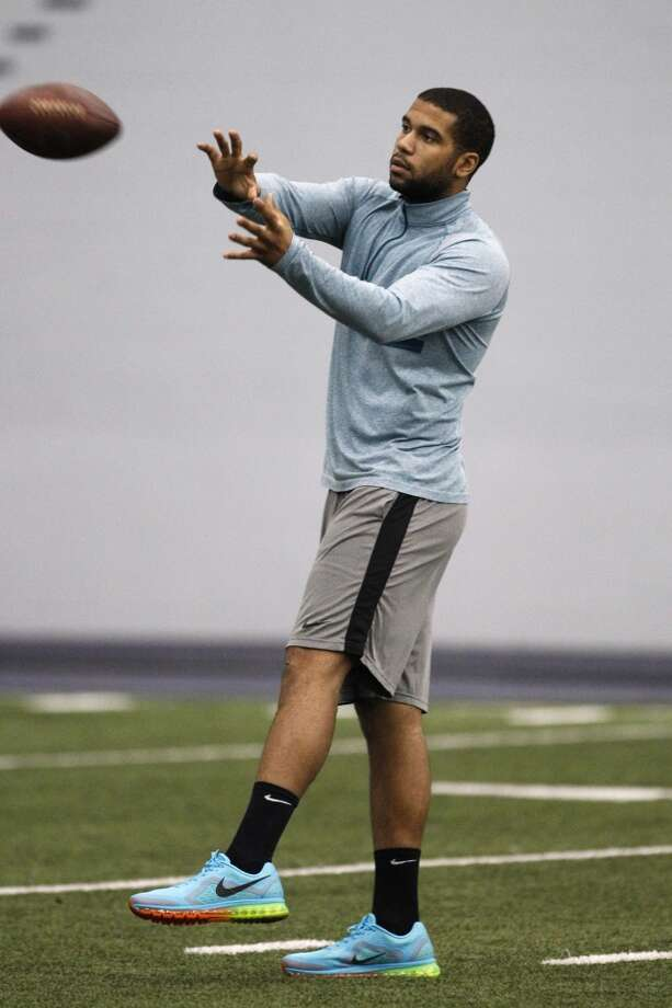 Washington tight end Austin Seferian-Jenkins plays catch on the sidelines of the NFL football pro day, Wednesday, April 2, 2014, in Seattle. (AP Photo/Joe Nicholson) Photo: AP