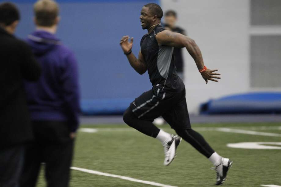 Washington defensive back Sean Parker runs the 40-yard dash at NFL football pro day, Wednesday, April 2, 2014, in Seattle. (AP Photo/Joe Nicholson) Photo: AP