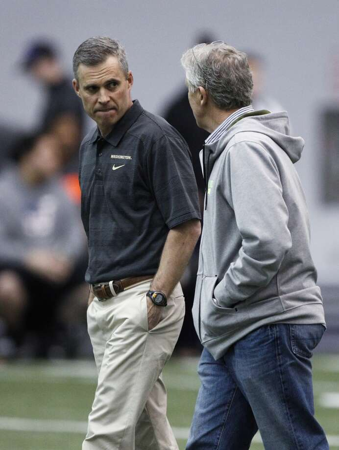 Seattle Seahawks coach Pete Carroll, right, talks with Washington coach Chris Petersen at Washington's NFL football pro day, Wednesday, April 2, 2014, in Seattle. (AP Photo/Joe Nicholson) Photo: AP