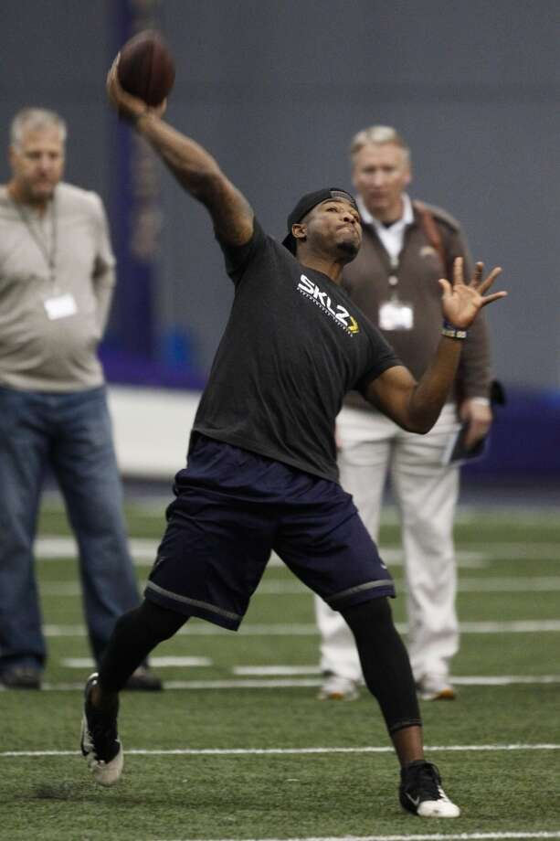 Washington quarterback Keith Price throws during NFL football pro day, Wednesday, April 2, 2014, in Seattle. (AP Photo/Joe Nicholson) Photo: AP