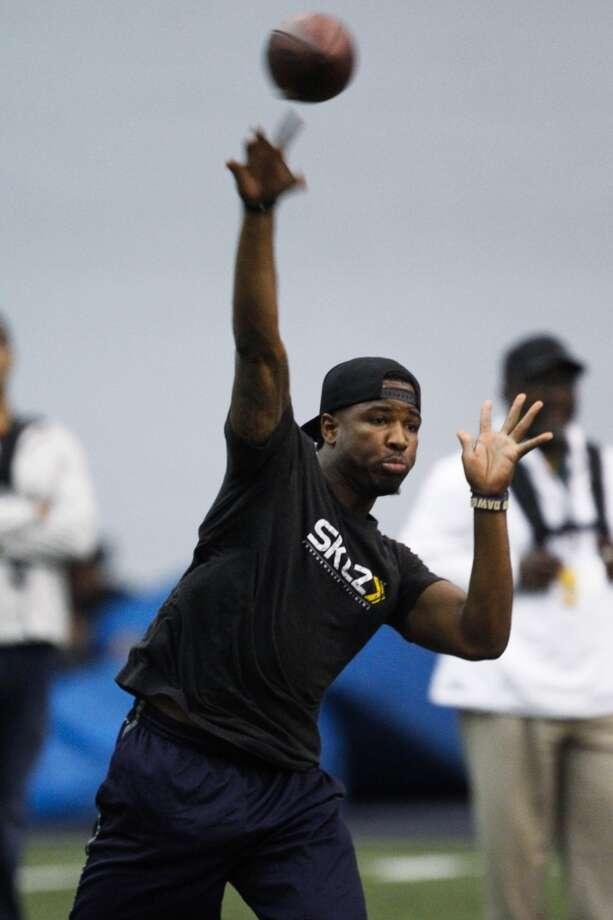 Washington quarterback Keith Price throws during NFL football pro day, Wednesday, April 2, 2014, in Seattle. (AP Photo/Joe Nicholson) Photo: AP