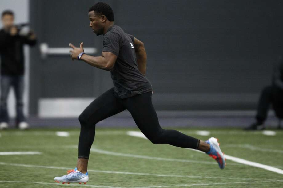 Washington quarterback Keith Price runs the 40-yard dash at NFL football pro day on Wednesday, April 2, 2014, in Seattle. (AP Photo/Joe Nicholson) Photo: AP
