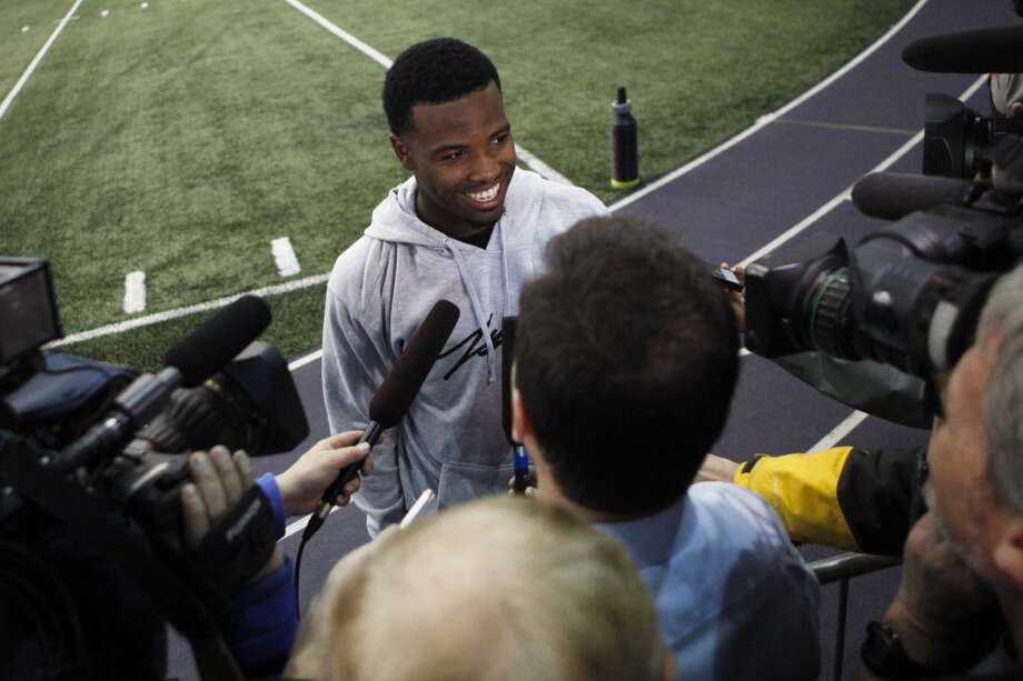 Washington quarterback Keith Price talks with reporters following NFL football pro day, Wednesday, April 2, 2014, in Seattle. (AP Photo/Joe Nicholson) Photo: AP