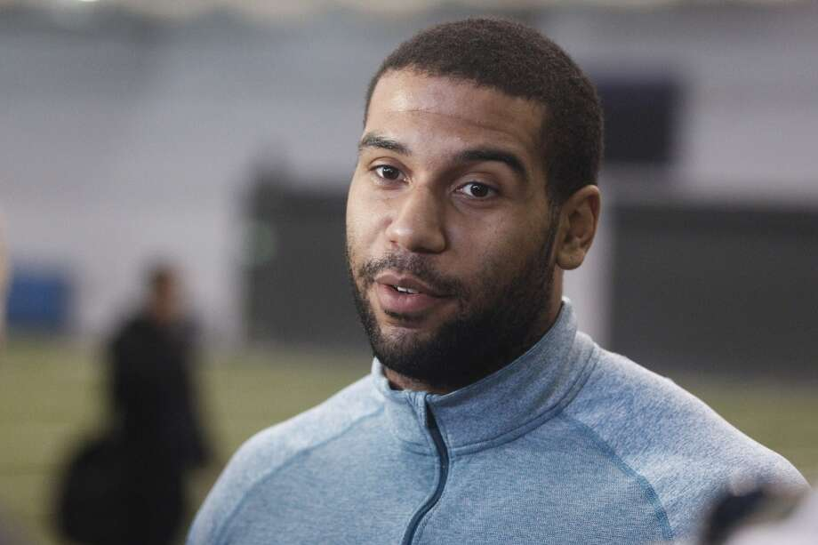 Washington tight end Austin Seferian-Jenkins talks with reporters following NFL football pro day, Wednesday, April 2, 2014, in Seattle. (AP Photo/Joe Nicholson) Photo: AP