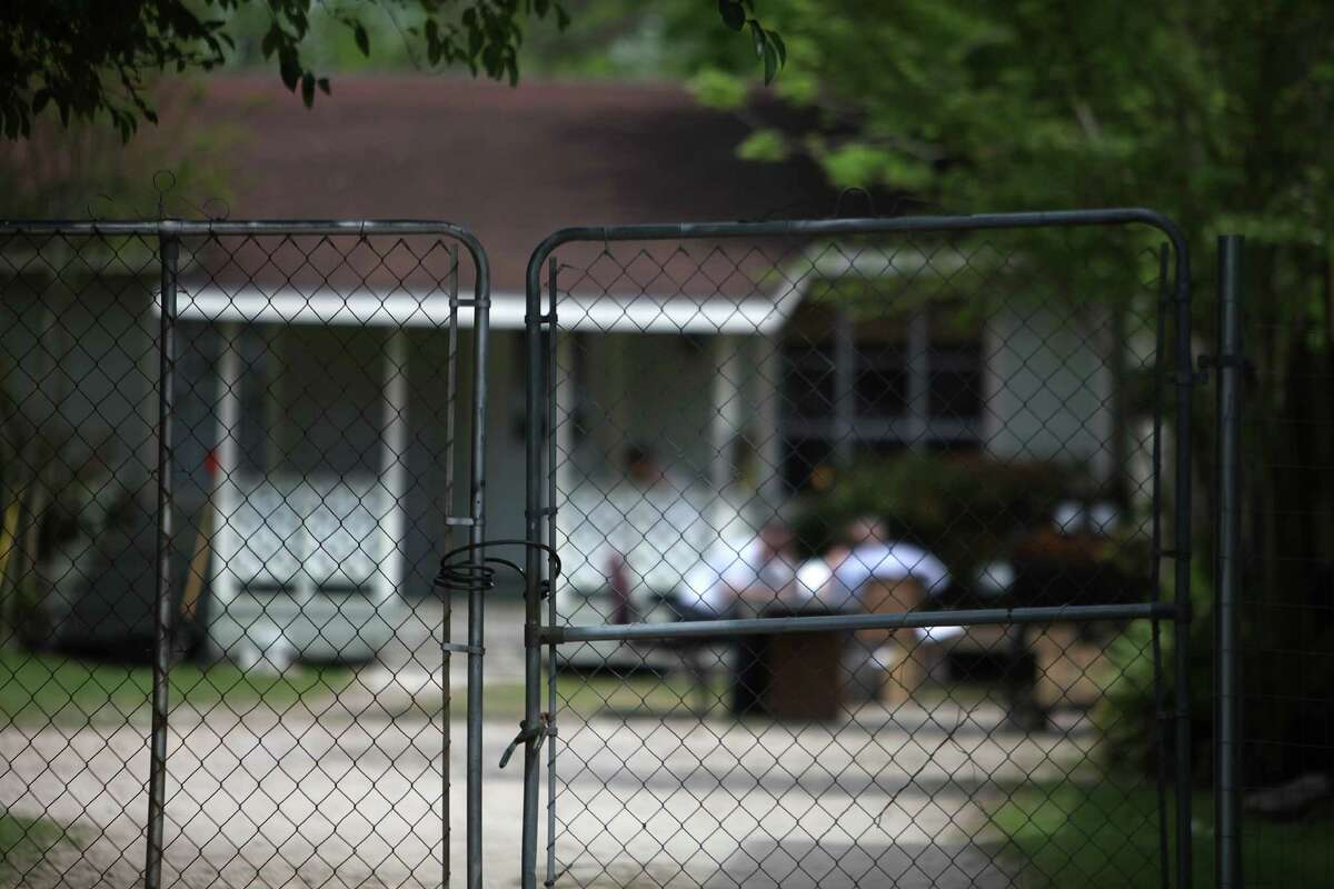 A locked fence keeps alleged high-risk sex offenders inside the half-way house located in the Acres Home community on April 2, 2014, in Houston, Tx.