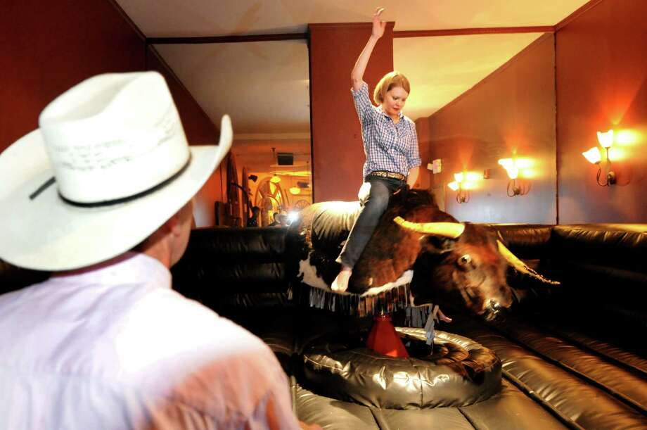 And if you're looking for more excitement, you can also ride the mechanical bull at the City Beer Hall. Photo: Cindy Schultz, Albany Times Union / 00013809A