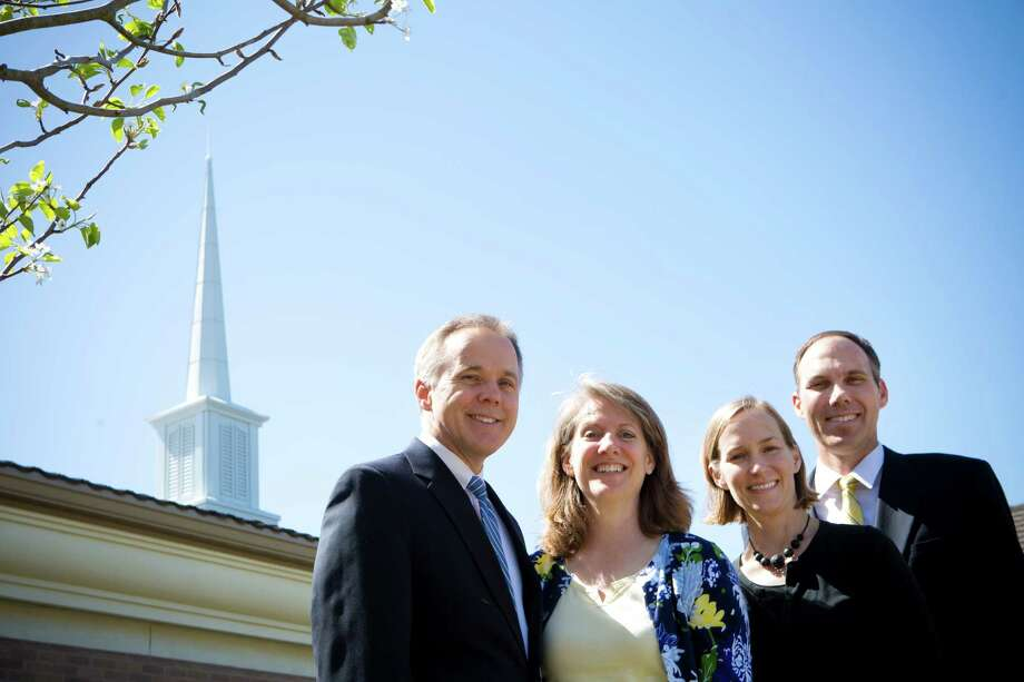 The Church of Jesus Christ of Latter-day Saints members Ken and Diane Barrow, left, of Sugar Land and Alexis and Jon Schmitt of Friendswood will supervise youth missionaries in South Korea and San Diego, respectively. Photo: Marie D. De Jesus, Staff / © 2014 Houston Chronicle