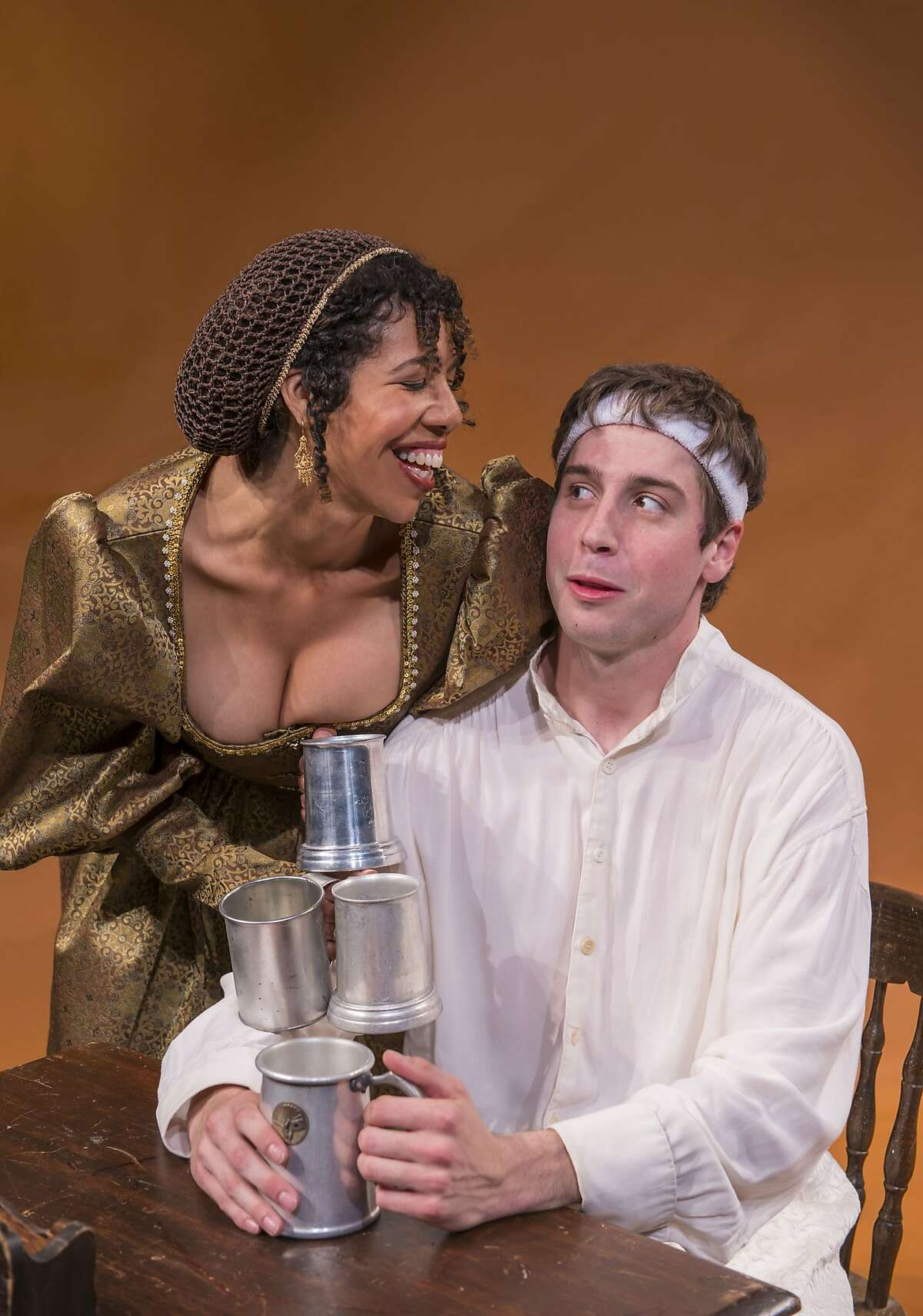 University senior Hamlet (Jeremy Kahn, right) catches the eye of a bar maid (Elizabeth Carter) in David Davalos'