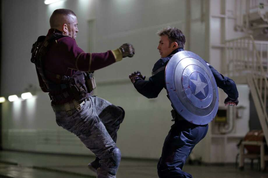 "This image released by Marvel shows George St-Pierre, left, and Chris Evans in a scene from ""Captain America: The Winter Soldier."" (AP Photo/Marvel-Disney, Zade Rosenthal) ORG XMIT: NYET520 Photo: Zade Rosenthal / Marvel/Disney"