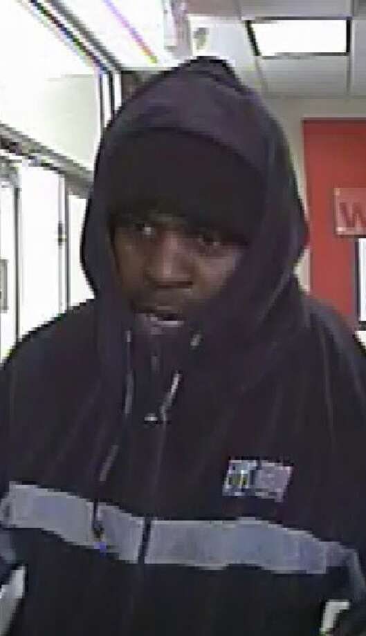 Photo of man police say robbed a Colvin Avenue Key Bank on March 27. (Albany police photo)