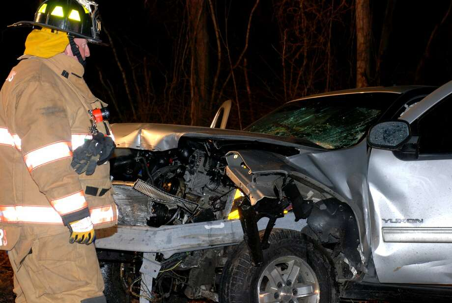 A driver whose car was impaled by a guard rail after veering off the Slingerlands Bypass just before 4 a.m. Thursday was later charged with drunken driving, Bethlehem police said. (Thomas Heffernan Sr. / Special to the Times Union) Photo: Picasa
