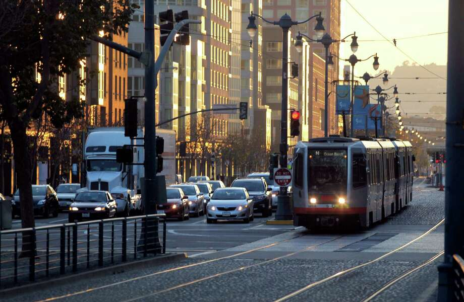 A streetcar passes traffic at 3rd and King streets in San Francisco, Ca., on Thursday Dec. 12, 2013. On May 7, 2015, a state appeals court blocked further construction of a long-planned Muni streetcar loop in San Francisco's central waterfront area a few blocks away while it considers a neighborhood group's argument that the project should be rerouted. Photo: Michael Macor / Michael Macor / The Chronicle / ONLINE_YES