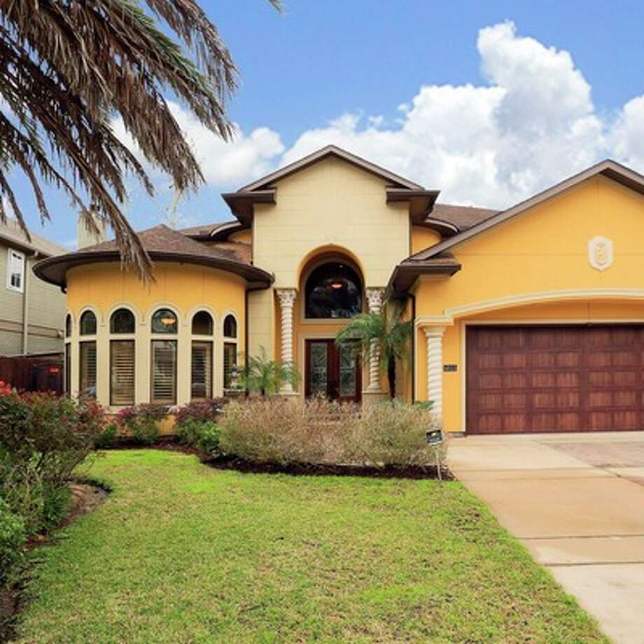 The Mediterranean-style home includes four bedrooms and 3.5 bathrooms.