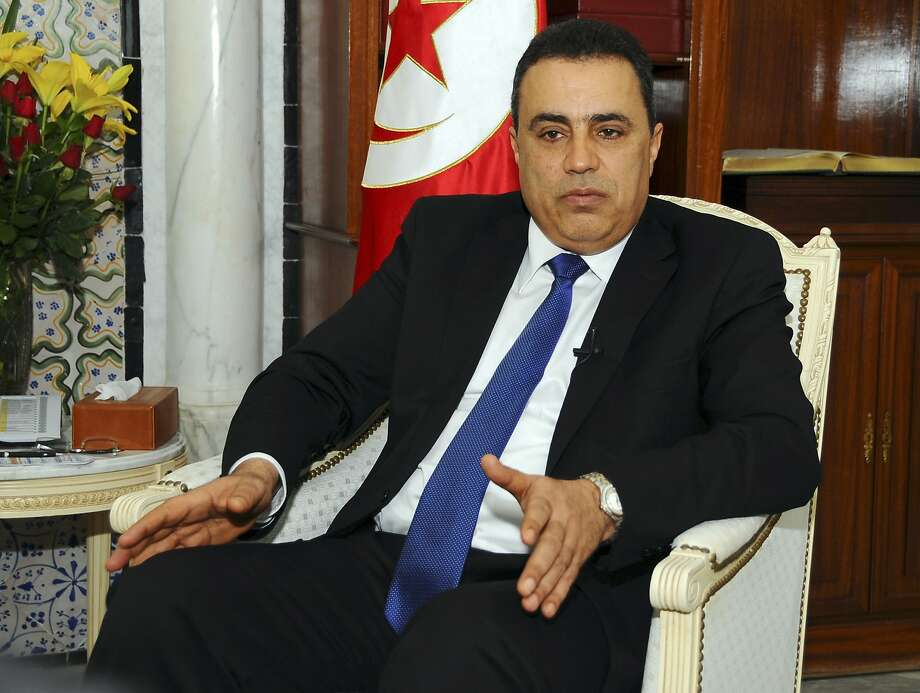 Prime Minister Mehdi Jomaa talks to reporters in Tunis before his meeting with President Obama. Photo: Hassene Dridi, Associated Press