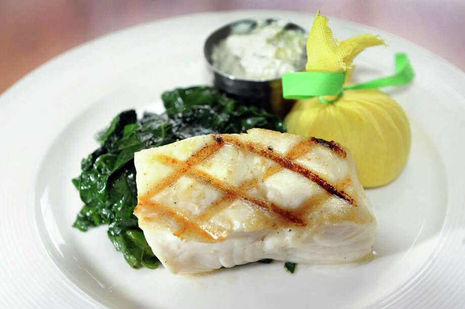 Reel Seafood Co.,195 Wolf Rd.,Albany, NY,518-458-2068. Grilled Chilean seabass with wilted Tuscan  kale, tzatziki and lemon on Thursday, March 27, 2014, at Reel Seafood  Co. (Cindy Schultz / Times Union)Visit Web site.Read our review. Photo: Cindy Schultz / 00026272A