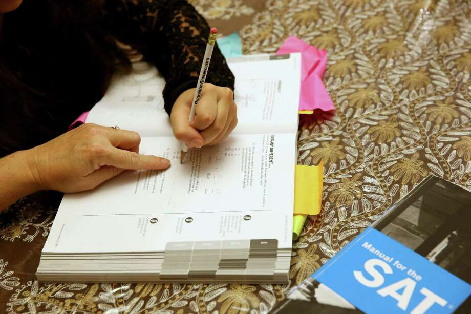 PEMBROKE PINES, FL - MARCH 06:  Carol McMullen-Pettit, a Premier Tutor at The Princeton Review, (L) goes over SAT test preparation with 11th grader, Suzane Nazir,  on March 6, 2014 in Pembroke Pines, Florida. Yesterday, the College Board announced the second redesign of the SAT this century, it is scheduled to take effect in early 2016.  (Photo by Joe Raedle/Getty Images) ORG XMIT: 477415463 Photo: Joe Raedle / 2014 Getty Images