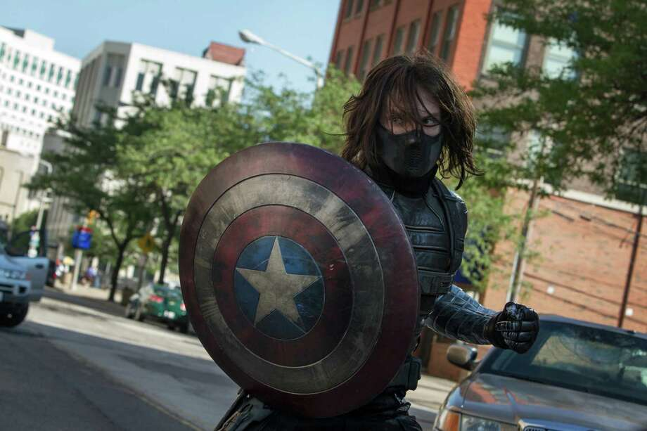 "This image released by Marvel shows Sebastian Stan in a scene from ""Captain America: The Winter Soldier."" (AP Photo/Marvel-Disney) ORG XMIT: NYET527 / Marvel/Disney"