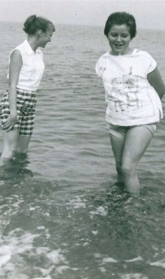 Sisters Nancy  (left) and Karen  play in Lake Erie at Point Pelee in Canada during a family vacation in the late '50s. Photo: Courtesy Karen Haram