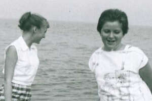 Sisters Nancy  (left) and Karen  play in Lake Erie at Point Pelee in Canada during a family vacation in the late '50s.