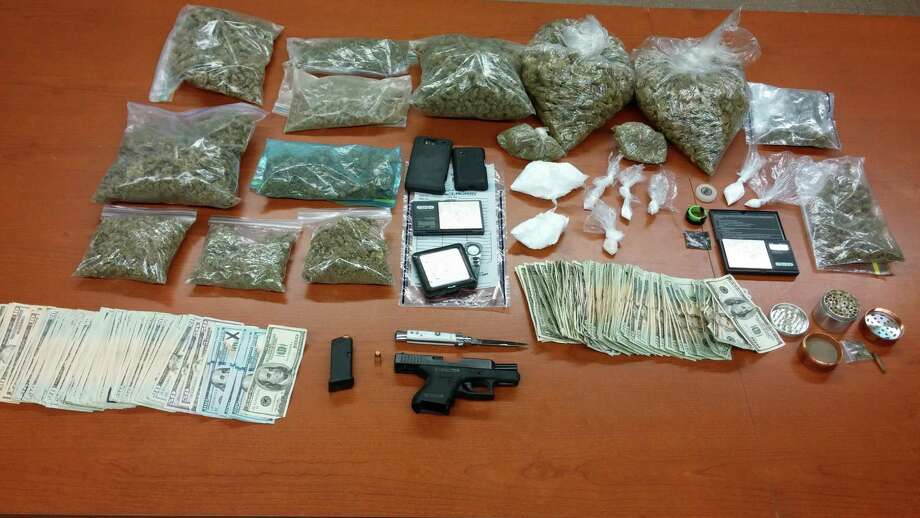 Marijuana, cocaine, MDMA, cash and a gun investigators say were seized Monday from a drug ring being run from a Guilderland motel. (Albany County Sheriff's Office photo)