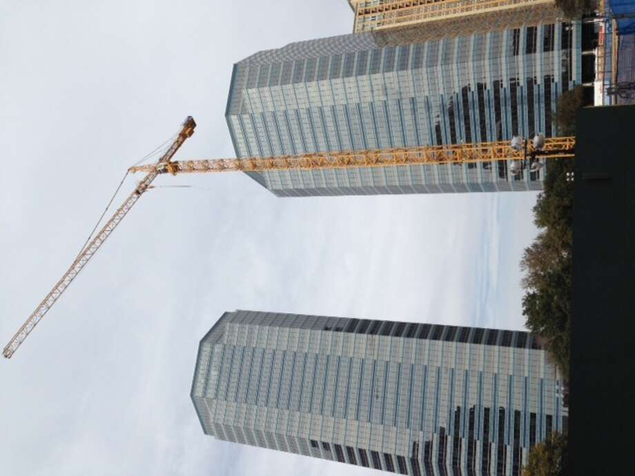 The crane is up for the BHP Billiton Petroleum building at 1500 Post Oak Blvd. Photo: Katherine Feser, Houston Chronicle