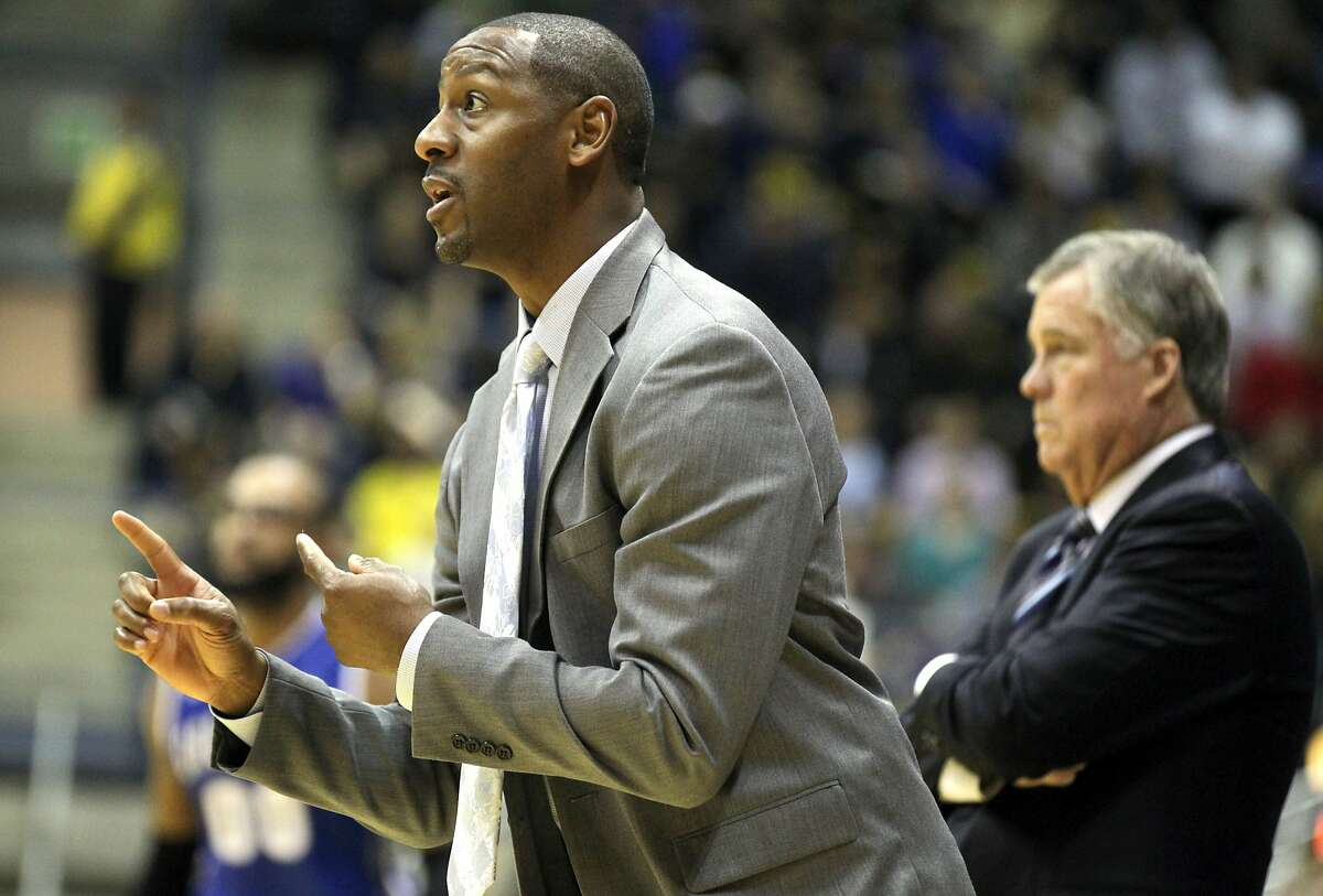 California's retiring coach Mike Montgomery (in background) made an unusually impassioned plea to name associate head coach Travis DeCurie (left) as his successor.