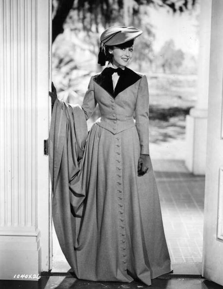 The Austrian film actress Luise Rainer, dressed in a riding habit, designed by Adrian in a scene from 'The Toy Wife'.Born: January 12, 1910 Photo: Hulton Archive, Getty Images / Moviepix