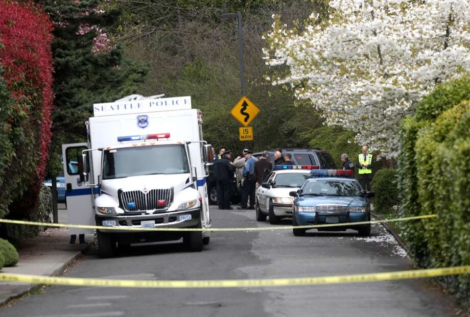 Seattle Police officers work the scene near 39th Avenue East where a suspect who police said robbed a bank was found and fatally shot by officers. Photo: Joshua Trujillo, Seattlepi.com