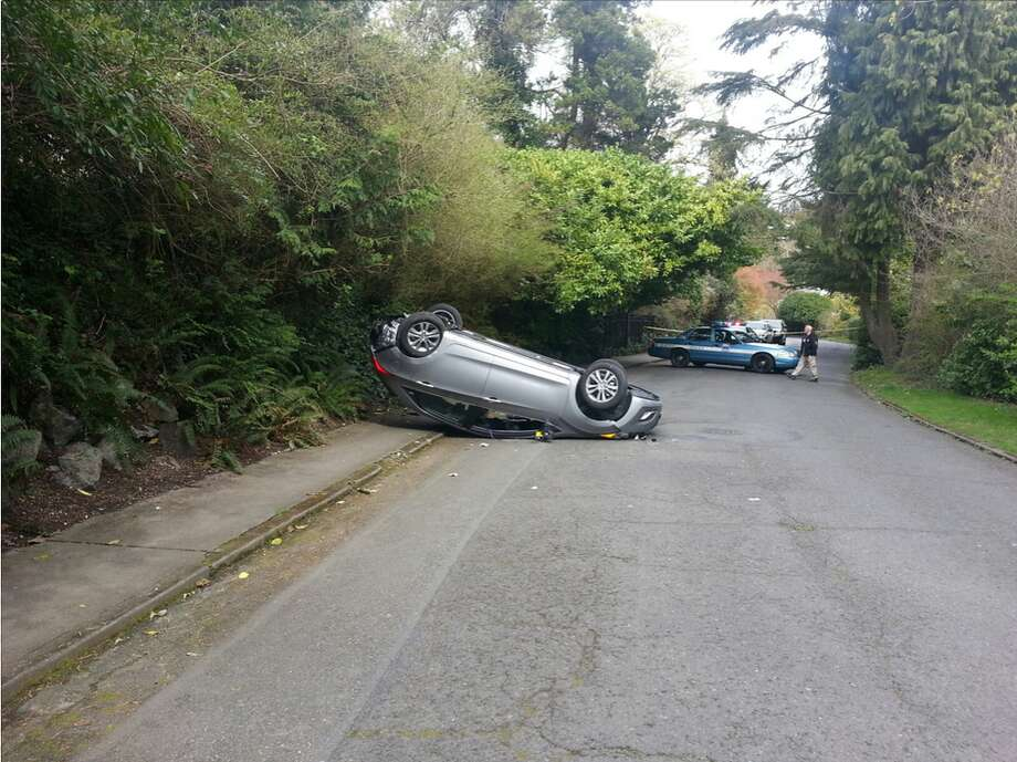 The robber's car crashed and flipped on its top at 39th Avenue East and East John Street. The driver ran off, initiating a police manhunt. Photo: Seattle Police Department