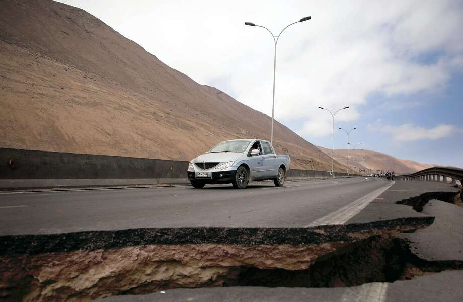 Caution, dip ahead: Motorists won't be driving this stretch of road in Iquique, Chile, anytime soon following an 