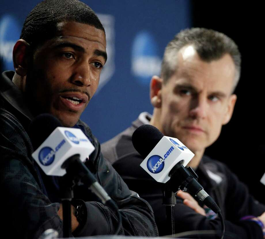 Connecticut head coach Kevin Ollie, left, and Florida head coach Billy Donovan participate in a joint news conference for their NCAA Final Four tournament college basketball semifinal game Thursday, April 3, 2014, in Dallas. Connecticut plays Florida on Saturday, April 5, 2014. Photo: David J. Phillip, AP / AP