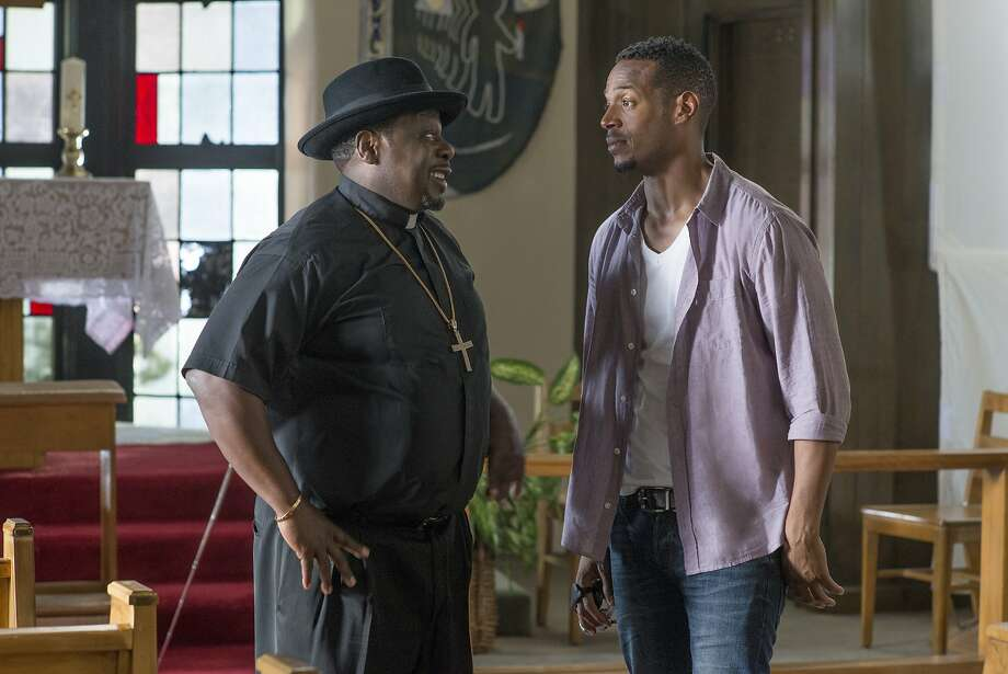"Marlon Wayans (right) appears with Cedric the Entertainer in  ""A Haunted House 2."" Photo: Open Road Films"