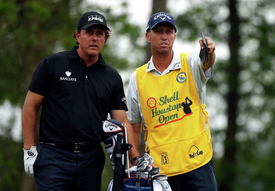 HUMBLE, TX - APRIL 03:  (L-R) Phil Mickelson of the United States talks with his caddy Jim Mackay during round one of the Shell Houston Open at the Golf Club of Houston on April 3, 2014 in Humble, Texas. Photo: Scott Halleran, Getty Images / 2014 Getty Images