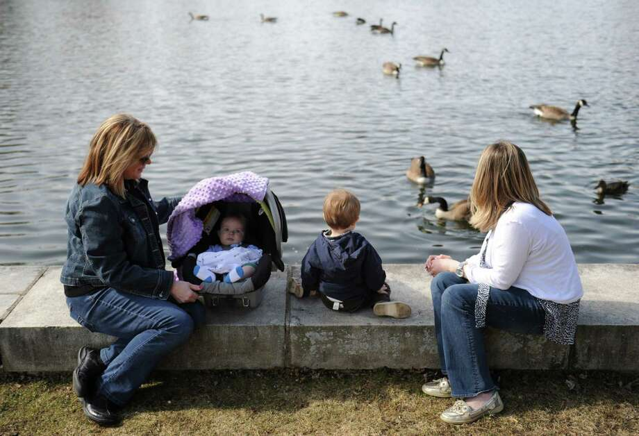 From left, grandmother Susan Nute, Logan Collins, 5 months, Bentley Collins, 2, and mother Lauren Collins, of Newtown, feed geese at Hawley Pond in Newtown, Conn. Thursday, April 3, 2014. Photo: Tyler Sizemore / The News-Times