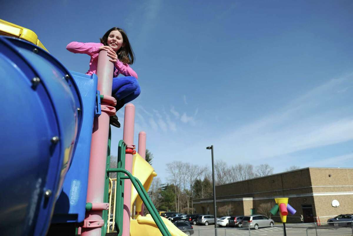 Catarina Da Rocha, 10, of Newtown, climbs on the playground at Hawley Elementary School in Newtown, Conn. Thursday, April 3, 2014.