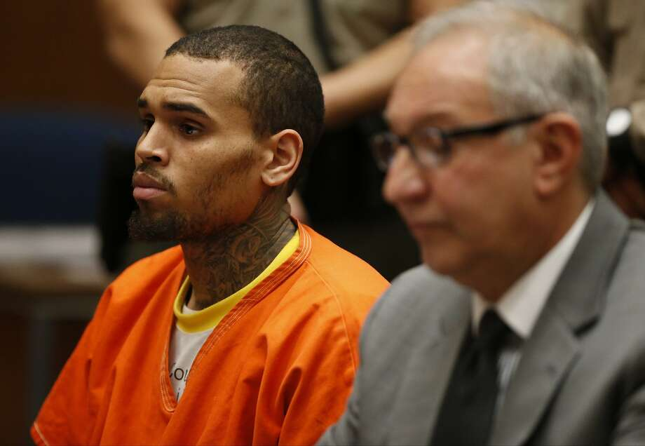Chris Brown (left), with attorney Mark Geragos, appears in court in Los Angeles on March 17. Photo: Lucy Nicholson, Associated Press
