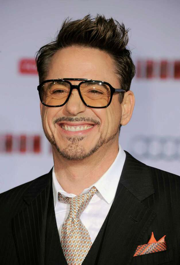 "Actor Robert Downey Jr. arrives at the world premiere of Marvel's ""Iron Man 3"" at the El Capitan Theatre on Wednesday, April 24, 2013, in Los Angeles. (Photo by Jordan Strauss/Invision/AP) Photo: Jordan Strauss / Invision"