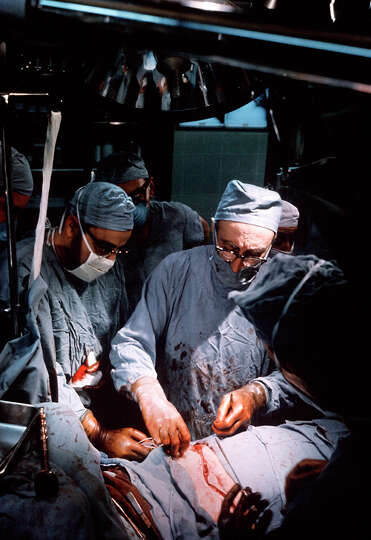 Dr Michael Debakey Performs An Operation To Implant An