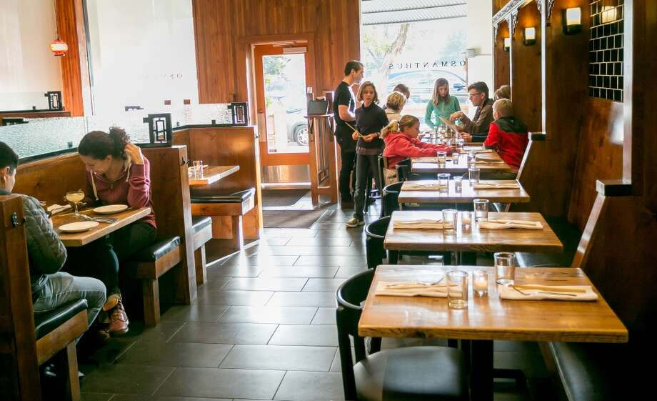 Diners enjoy dinner at Osmanthus in Oakland. Photo: John Storey, Special To The Chronicle