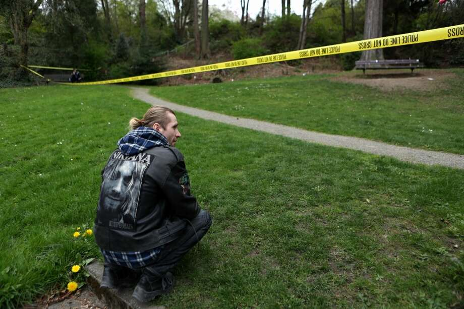 Slava Semykin, a visitor from Russia, looks over the crime scene where Seattle Police shot and killed a suspected bank robber near the former home of late Nirvana singer Kurt Cobain. Photo: Joshua Trujillo, Seattlepi.com