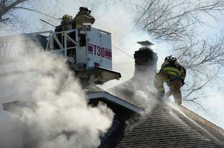 Firefighters battle a blaze at 6 Adams Place Thursday, April 3, 2014, in Delmar, N.Y. (Skip Dickstein / Times Union) Photo: SKIP DICKSTEIN