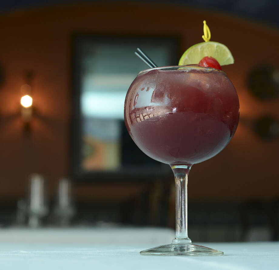 Sangria has evolved since writer James Michener first encountered it in Spain in the 1960s. El Jarro de Arturo's wine drink is fortified with gin and brandy. Photo: Billy Calzada / San Antonio Express-News / SAN ANTONIO EXPRESS-NEWS