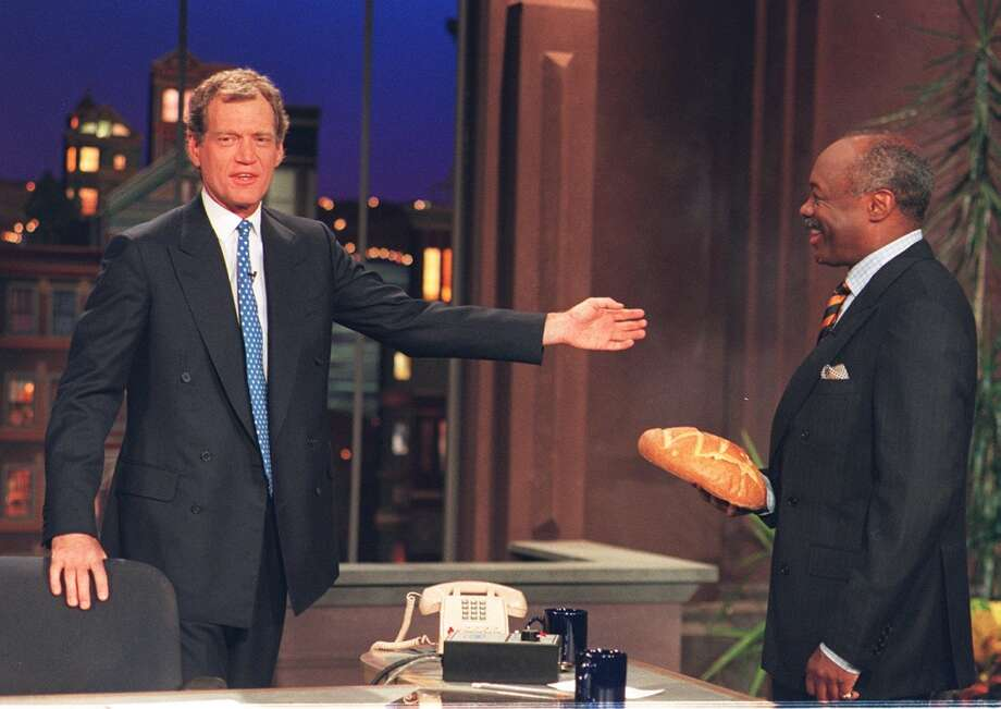 "David Letterman greets San Francisco mayor Willie Brown on  opening night of the show's filming in San Francisco. During a taping of his show Thursday, April 3, 2014, Letterman said he has informed his CBS bosses that he will step down in 2015, when his current contract expires. He told his audience he expects his departure will be ""at least a year or so"" from now. Photo: TONY ESPARZA, PHOTOG & CBS"