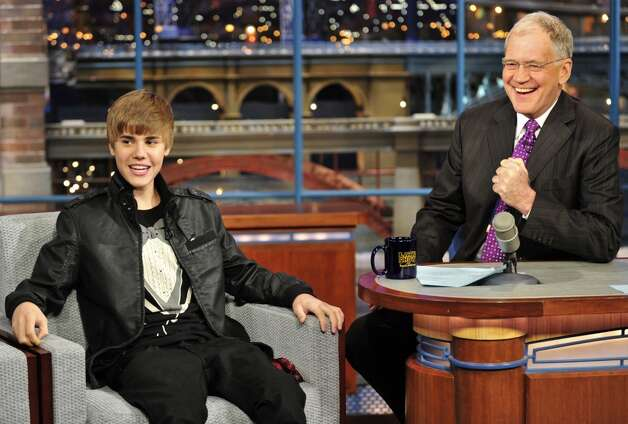 In this photo released by CBS Entertainment, Justin Bieber, left, appears with Late Show host David Letterman wearing a tuxedo shirt during taping for CBS-TV's The Late Show with David Letterman, Monday, Jan. 31. 2011, in New York. Photo: John Paul Filo, AP