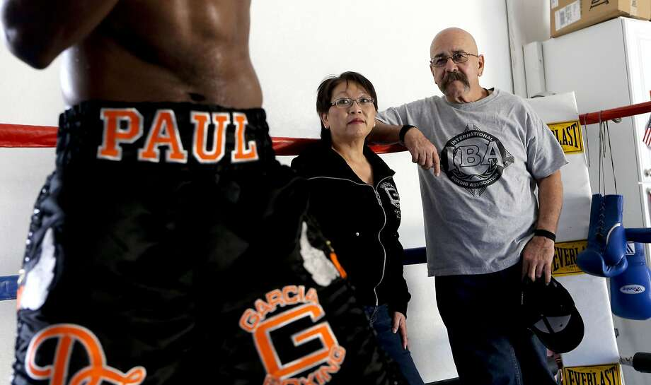 The wife-husband, manager-trainer team of Kathy and Max Garcia keep an eye on one of their boxers, Paul Mendez. Photo: Michael Macor, The Chronicle