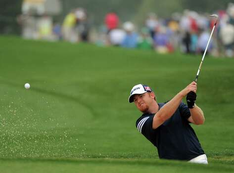 J.B. Holmes hits out of a green side bunker on No.8 during the first round of the Shell Houston Open, Thursday, April 3, 2014, at the Golf Club of Houston in Humble. Photo: Eric Christian Smith, For The Chronicle