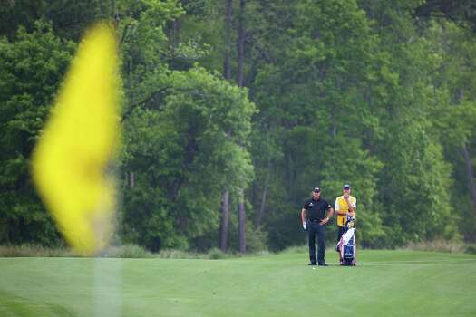Phil Meckelson studies the second hole from afar during the first round of the Shell Houston Open, Thursday, April 3, 2014, in Humble. Photo: Marie D. De Jesus, Houston Chronicle / © 2014 Houston Chronicle