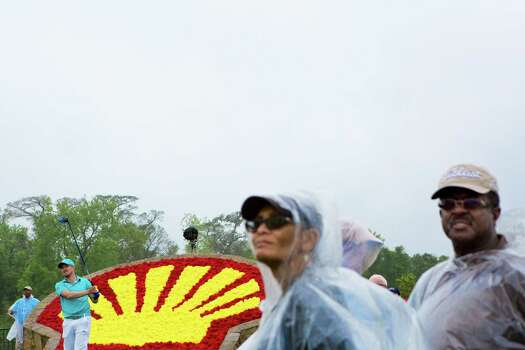 Adawn Reed and her husband Larry Reed watch Jonas Blixt tee off from the 18th hole under the rain during the Shell Houston Open round first, Thursday, April 3, 2014, in Humble. Photo: Marie D. De Jesus, Houston Chronicle / © 2014 Houston Chronicle